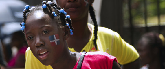 Dominicans of Haitian descent with the Dominican flag painted on their cheeks demonstrate in front of the Central Electoral Board to demand their Dominican citizenship in Santo Domingo on March 12, 2013. AFP PHOTO / Erika SANTELICES | Getty