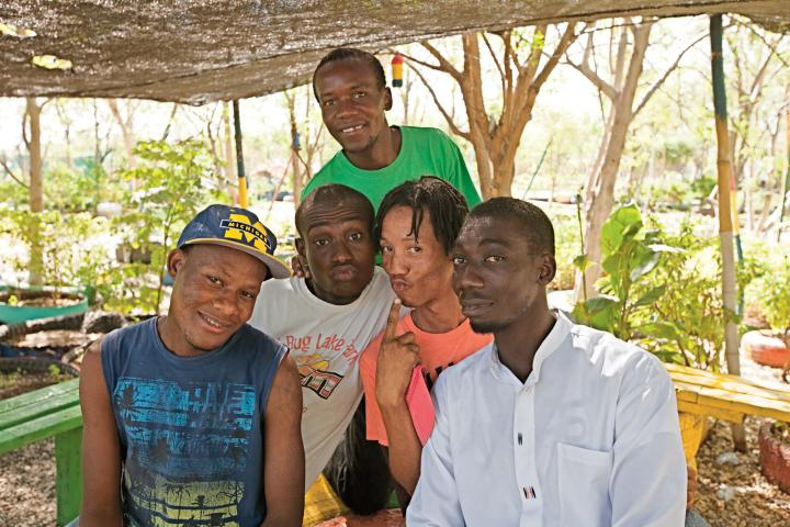 Through a new MCC-funded video, actors and comedians (from left) Luckmane Charles, Edoine Jean Marck, Josue Francois, Ronald Jean Batiste and Ezaie Simon use humor to share and promote earthquake-resistant building techniques. (See photo below from the video.)