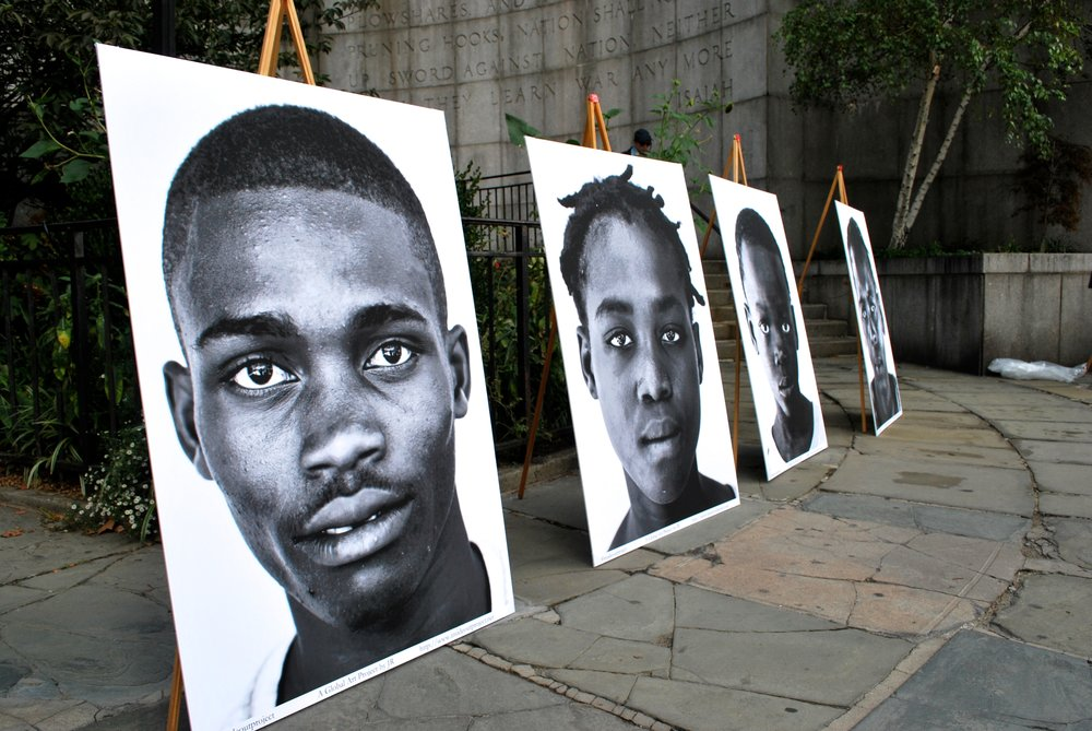 Cholera victims' portraits before going on display for an MCC-supported campaign across from the UN in New York City. October 2015. Photo credit: Bea Lindstrom.