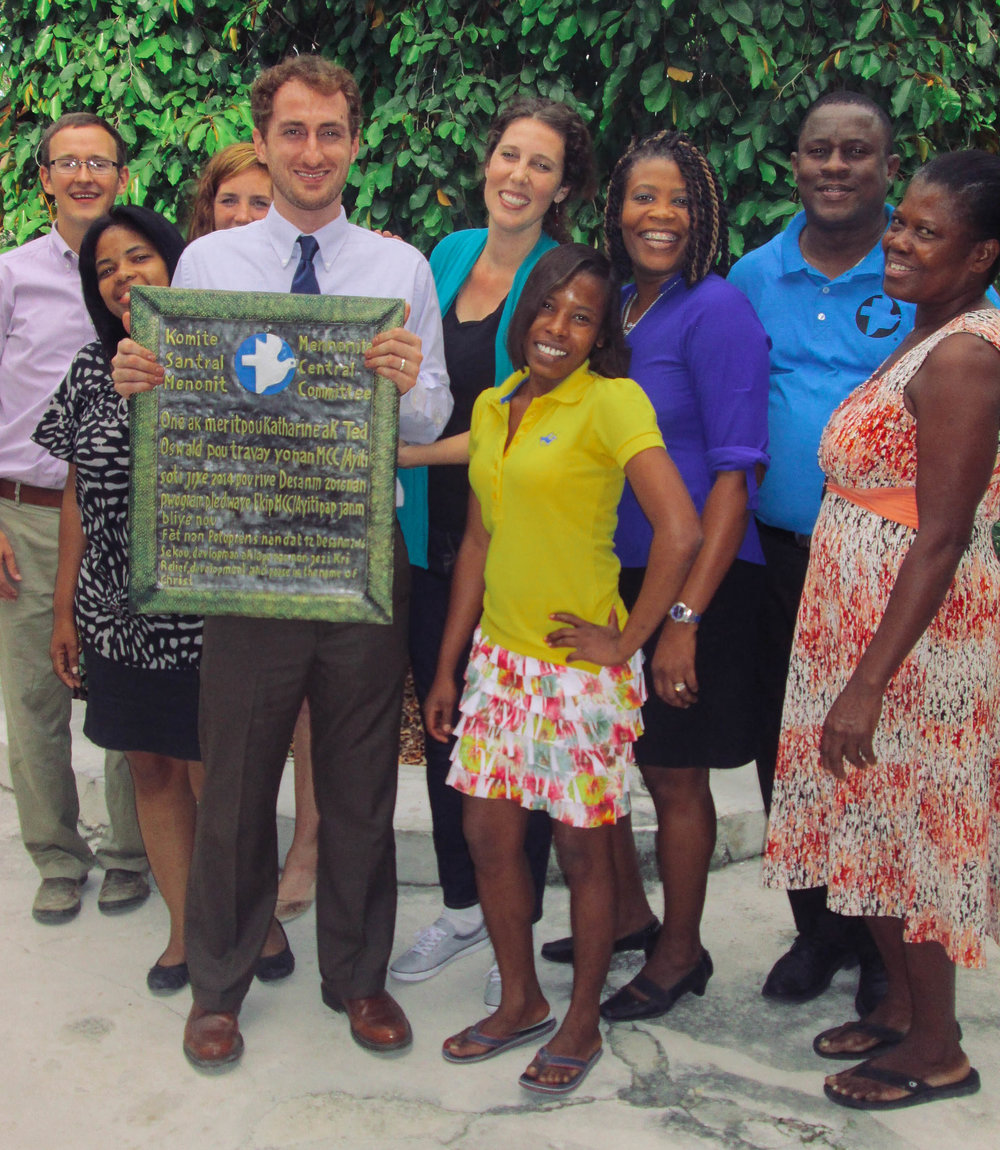 Ted Oswald (holding plaque) with MCC Haiti staff members.