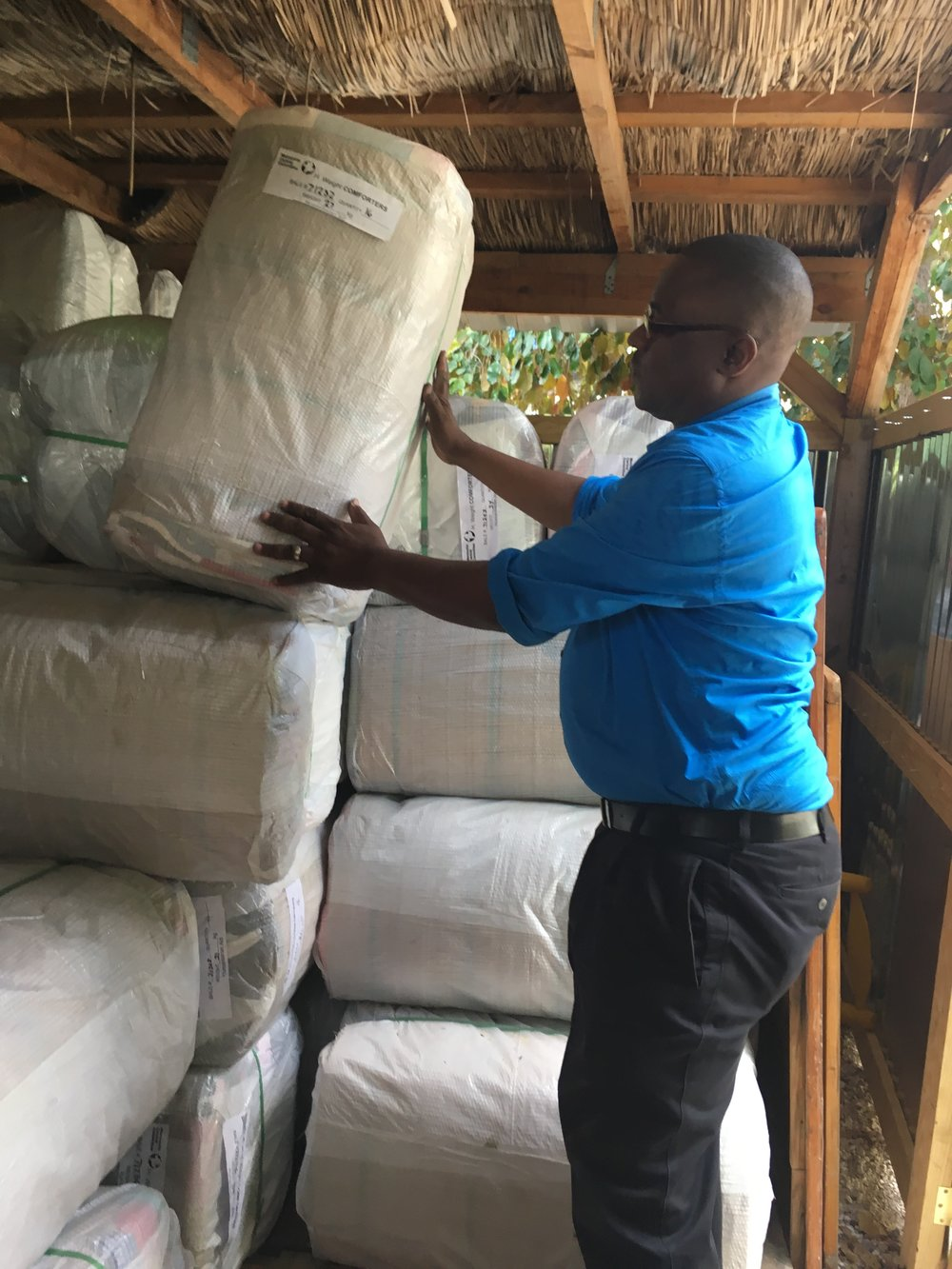 Pictured above, Herve Alcinna loading material aid in MCC Haiti storage facility on office grounds in preparation for Hurricane Irma.As a result of the significant earthquake response, MCC in Haiti began prepositioning material aid in Haiti rather than waiting to place orders after disasters in order to be able to respond more quickly.