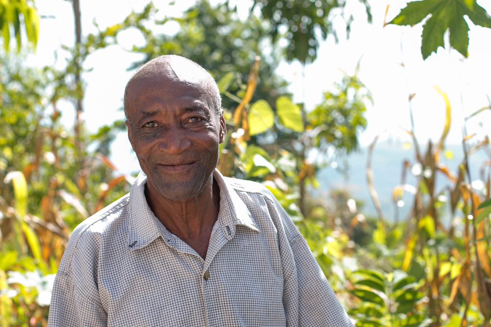 Although Haiti's south was hit most directly by Hurricane Matthew, communities like Wondo, high in the mountains of Haiti's Artibonite department, are particularly vulnerable to tropical storms, as heavy winds and rains can quickly wash away valuable soil and destroy entire crops. Pictured above, Antoine Calix in front of his garden in Wondo, Haiti. His garden was replanted after Hurricane Matthew as part of an  MCC-supported food security project  in the remote mountainside community.