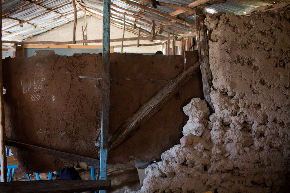 Damage to the interior wall of the primary school in Bingo caused by the October 6th 2018 earthquake. Many parents report that, after the earthquake, their children are afraid to enter buildings like homes or schools.