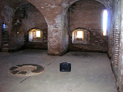 Inside Fort Gaines, with a photo of what is thought to be one of it's many ghosts