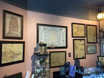 Photo of the inside of the new Serpents of Bienville Space, a view of the maps available for you to take home.