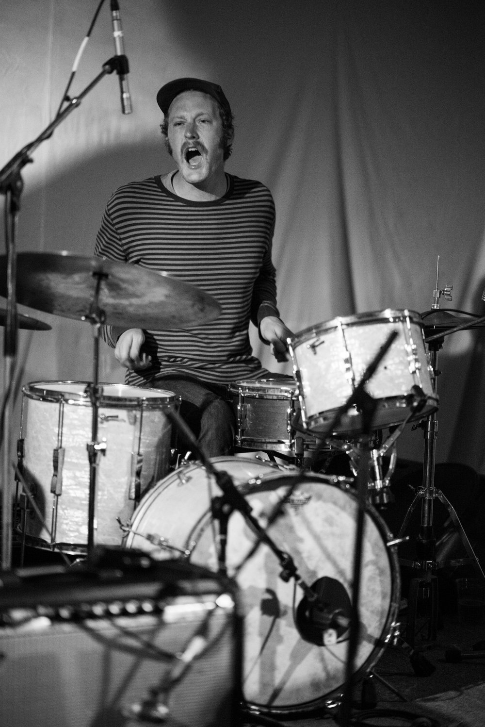 Jeff ripping on the drums and letting loose. Photo: fromthefringesphotography.com