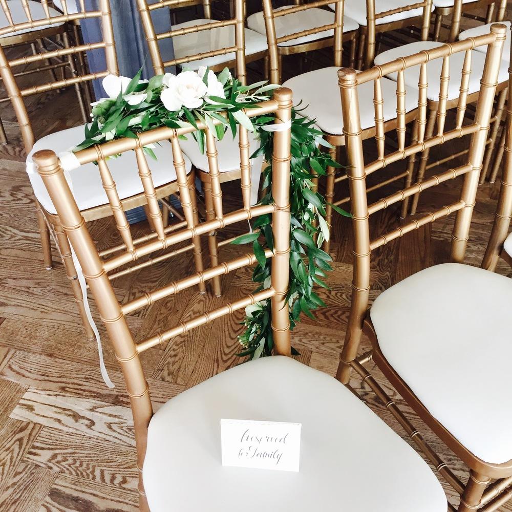 Big Love Wedding Design - Gold chiavari chair with greenery chair garland