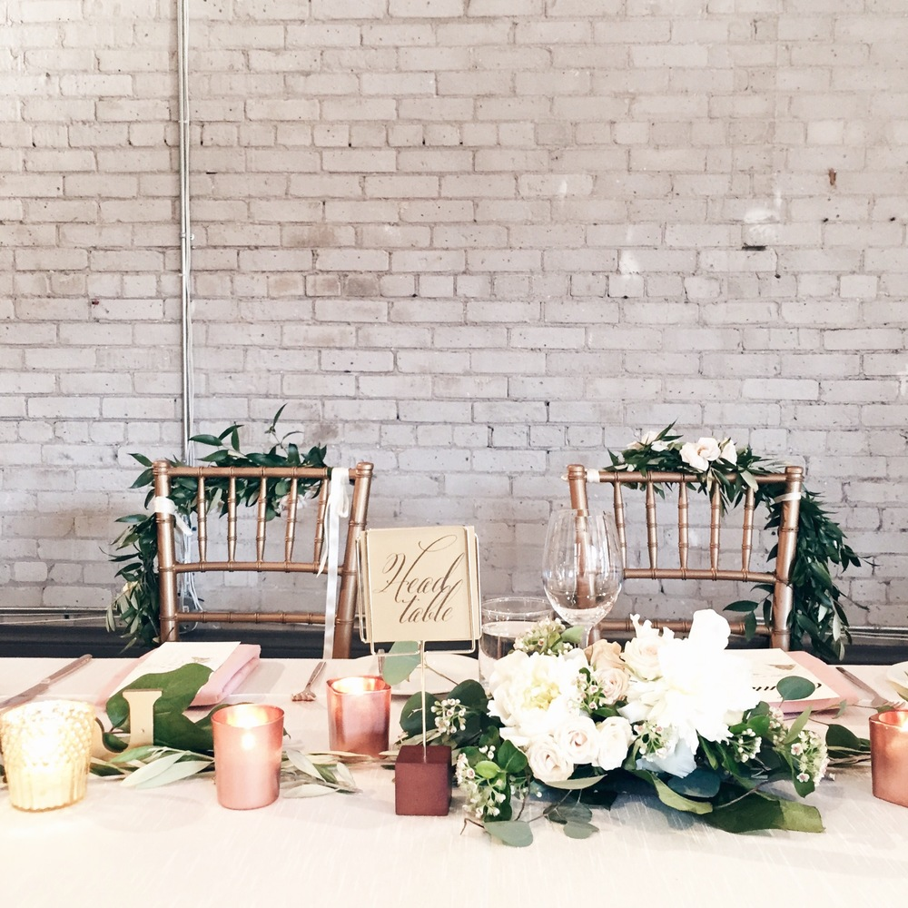 Big Love Wedding Design - Blush and gold head table with greenery table garland