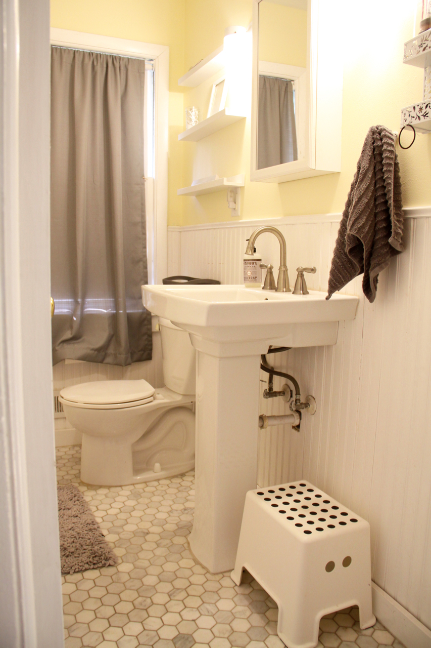 Bathroom with Marble Tile, Pedestal Sink
