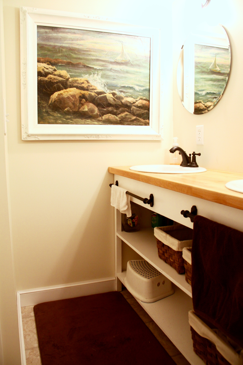 Bathroom with Open Shelves and Large Painting