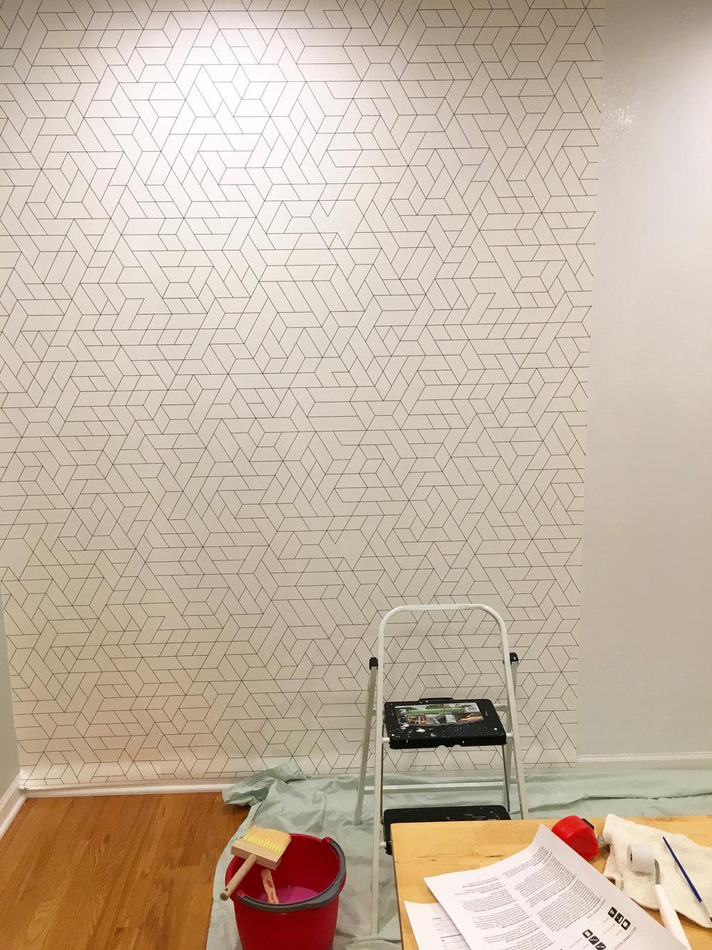 Photowall Wallpaper Being Hung