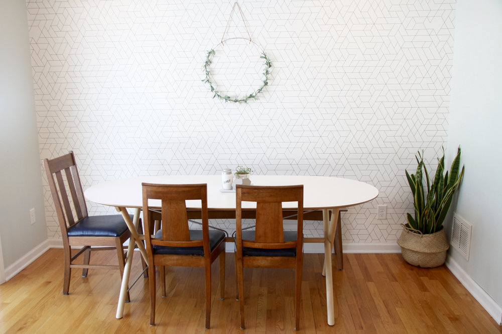 Mid century dining area with IKEA SLAHULT and graphic wallpaper