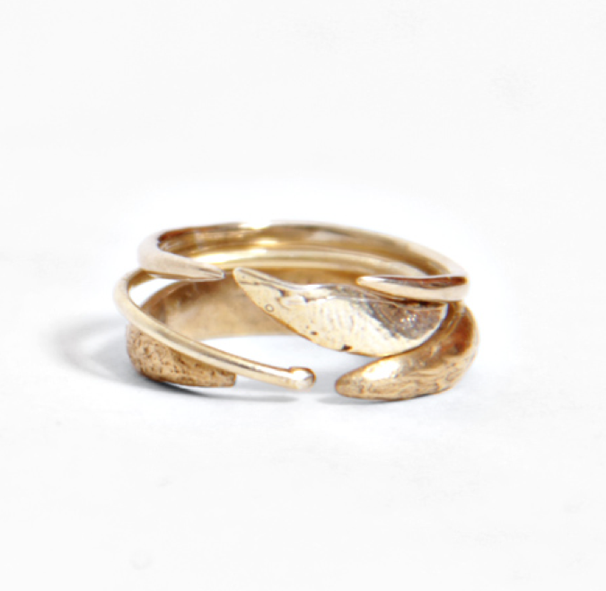 Wwake x 100 year party triple ring stack.png