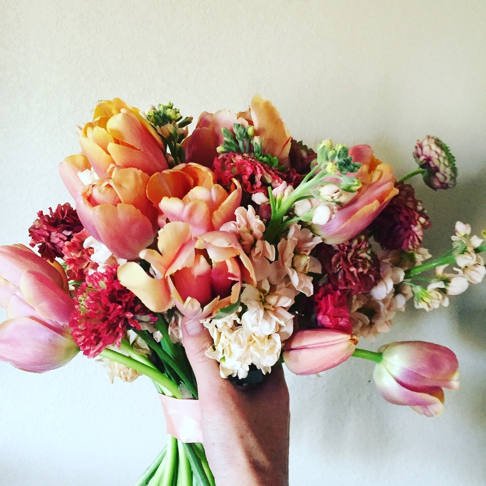 Pretty, peach hand tied garden style bouquet