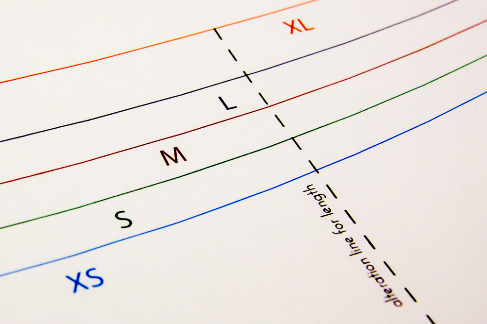 5 seasonal patterns on durable paper with color-coded sizing lines.