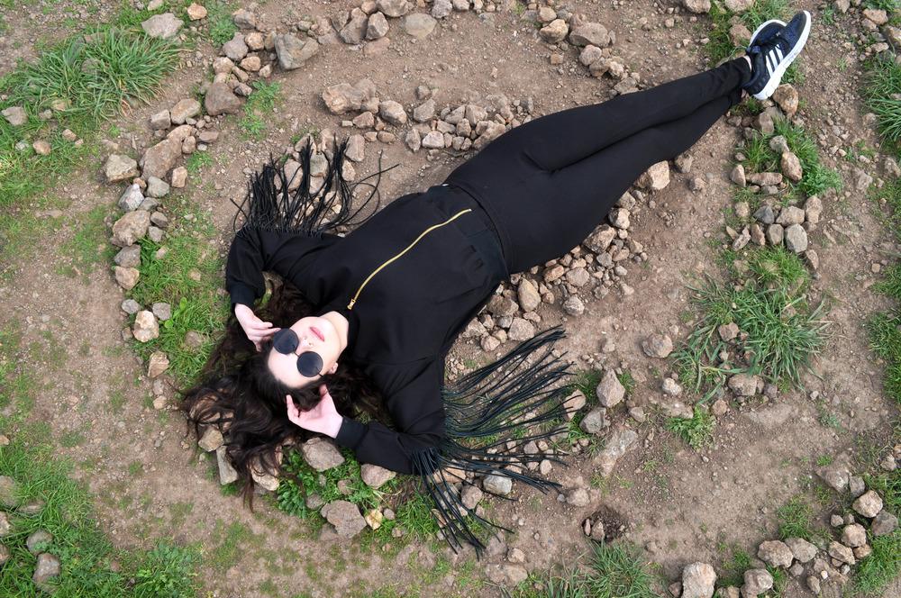 laying on rock circle.jpg