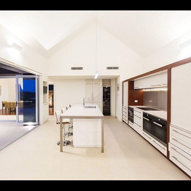 Clean White Lines | Eagle Bay Beauty on show | White Lacquer | Jarrah Timber Feature |Stainless Steel Island Frame |  #dunsborough #dunsboroughwoodworks #australia #furniture #kitchen #kitcheninspo #design #home #interiordesign #homedecor #bespoke #custom #cabinetry #interior #westernaustralia #perth #eaglebay