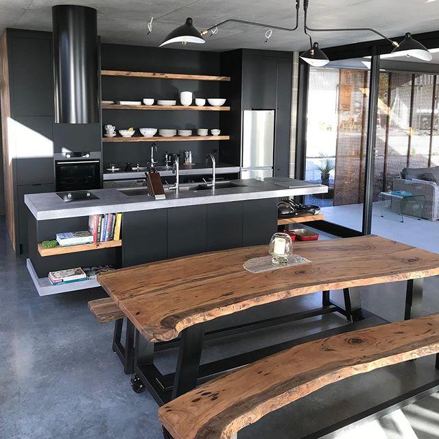 Marri Slab Table & Bench Seats | Kitchen features Black Matt Laminate | Marri Shelving | Concrete Benchtop  #dunsborough #dunsboroughwoodworks #australia #furniture #kitchen #kitcheninspo #design #home #interiordesign #homedecor #bespoke #custom #cabinetry #interior #westernaustralia #perth #dinjngtable #marri #concrete #blackmatt