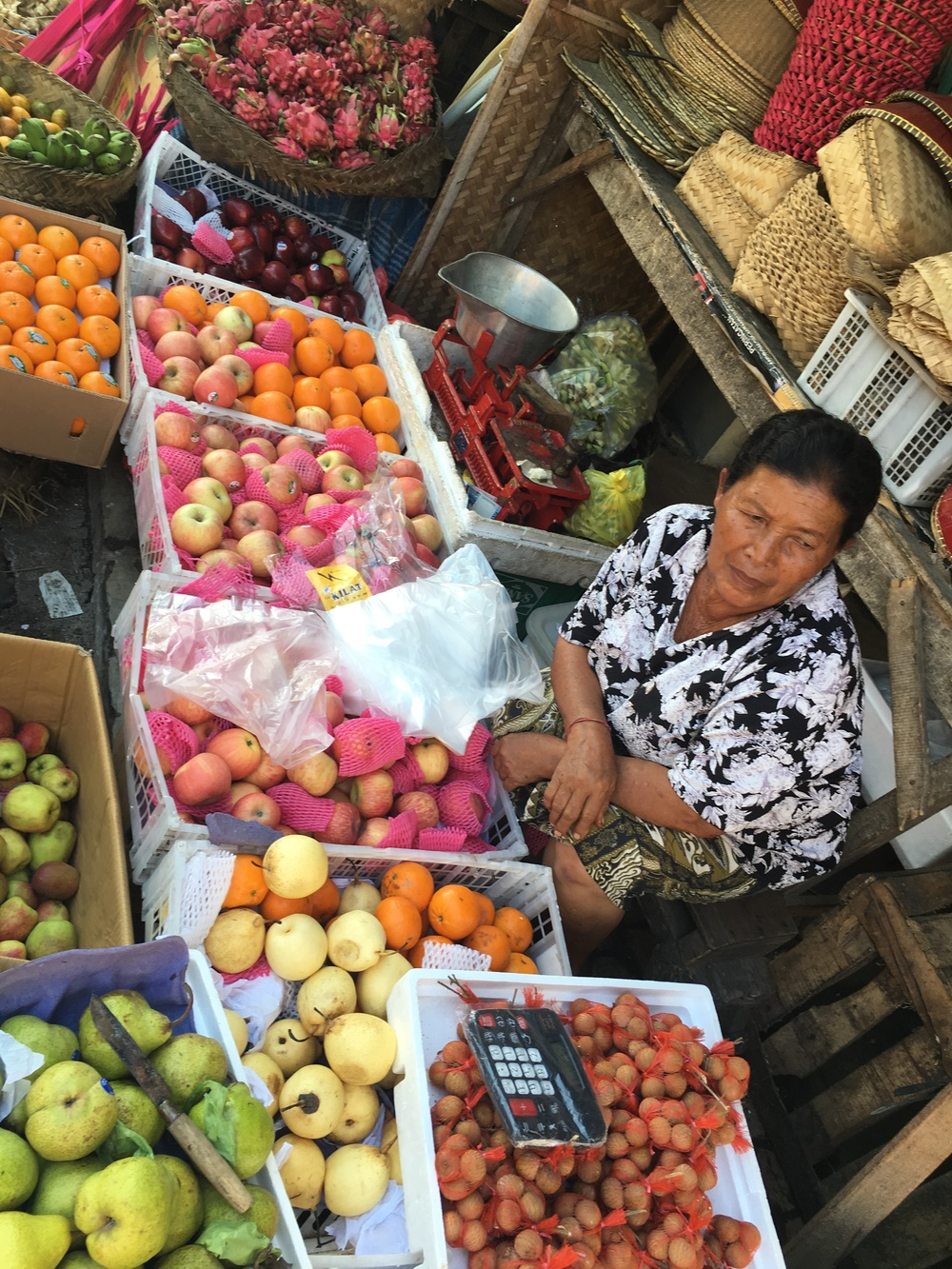 This seller has many different kinds of fruits available.  We tried a mangosteen.  Good stuff!