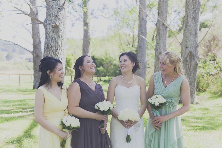 Multi- coloured bridesmaids dresses