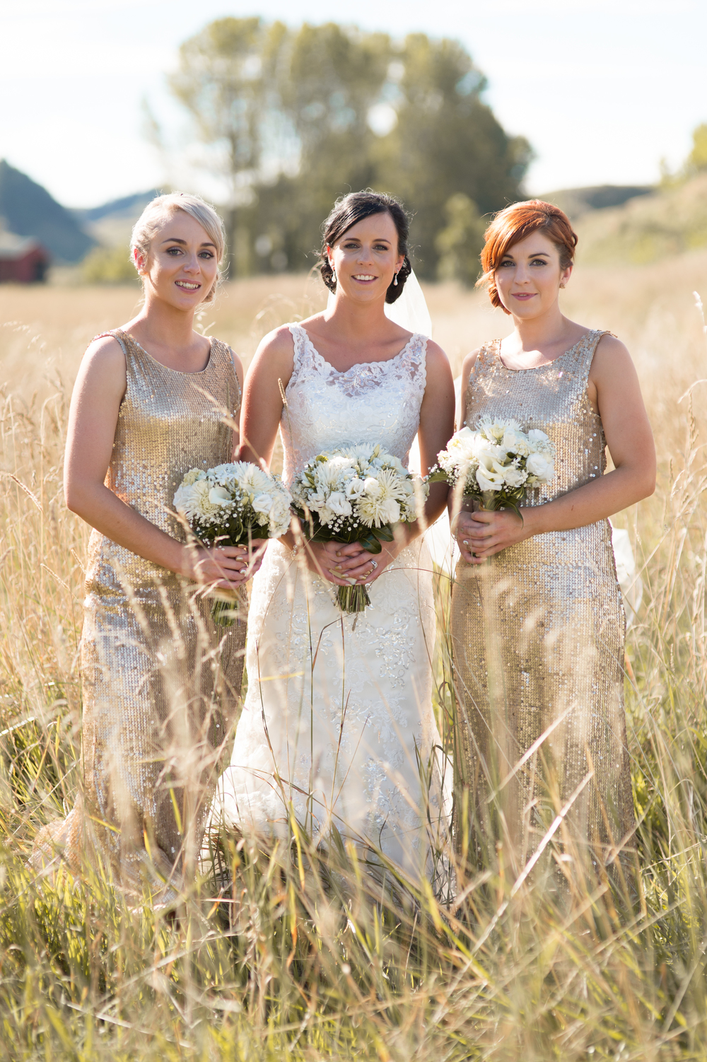 Stunning gold bridesmaids dresses | Astra Bridal Bride Megan | Photography by Laura Ridley | www.borrowedandblue.kiwi