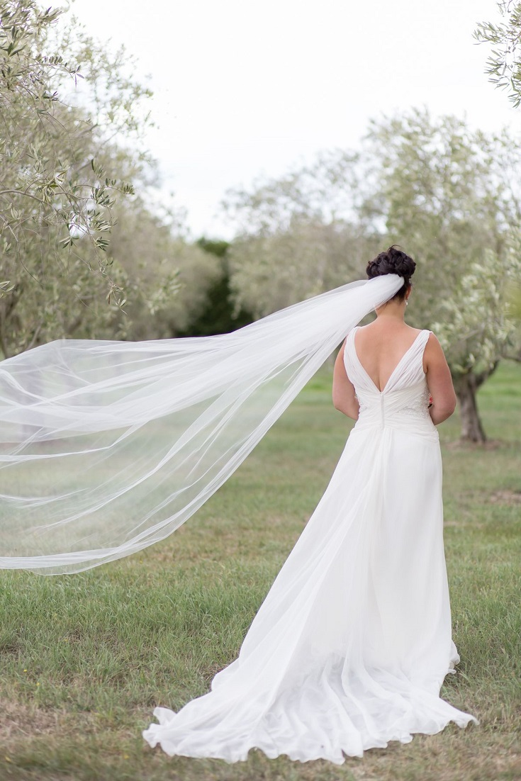 Astra bride Jasmine | Gorgeous back view of her Bonny gown and long veil  | Photography by Jo Moore |