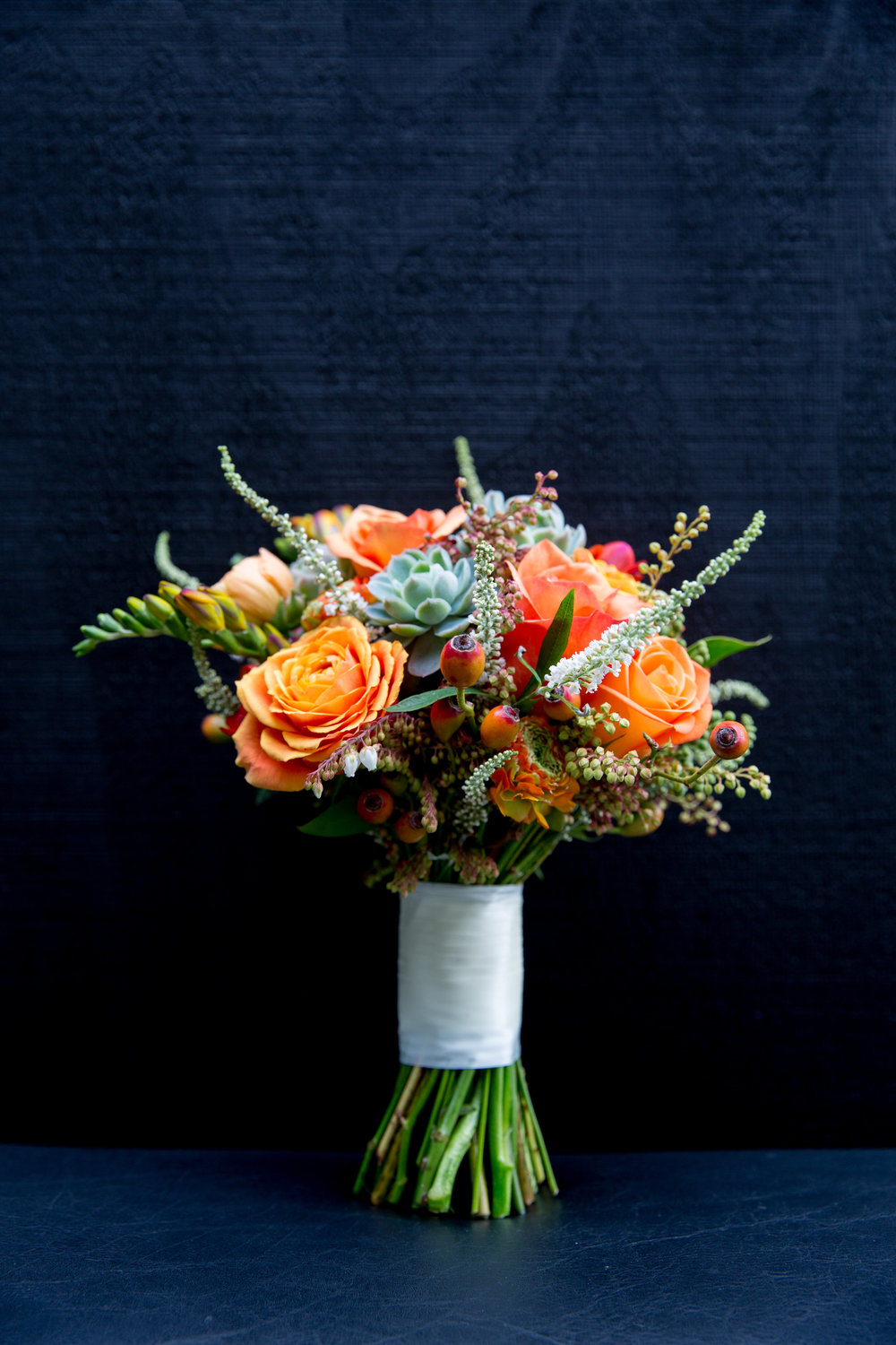 Orange wedding bouquet | Modern bride inspiration | photography by Tinted | Dress from Astra Bridal | www.borrowedandblue.kiwi