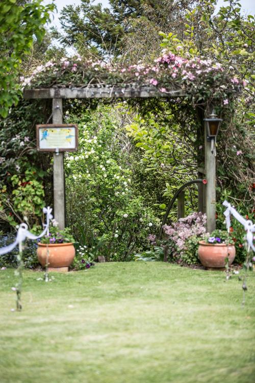 Floral Arch | Garden Wedding | Astra Bride Heleina | Maggie Sottero Gown |