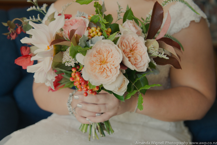 Floral bouquet of orange and peach | Astra bride Ariana | Photography Amanda Wignell |