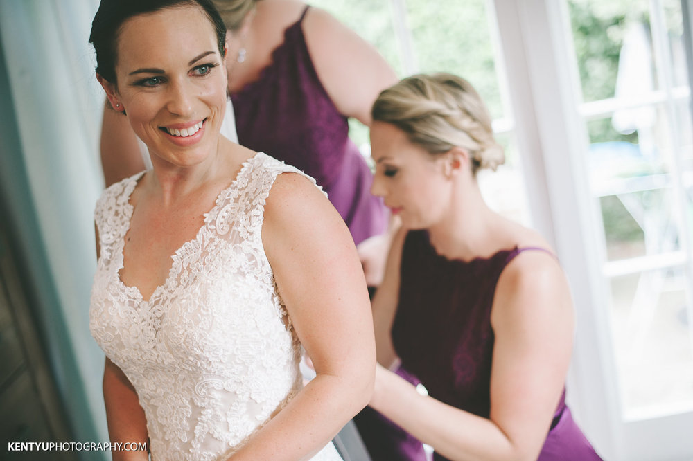 Bride getting dressed |Astra Bride Karla | Maggie Sottero Melanie | Kent Yu Photography |