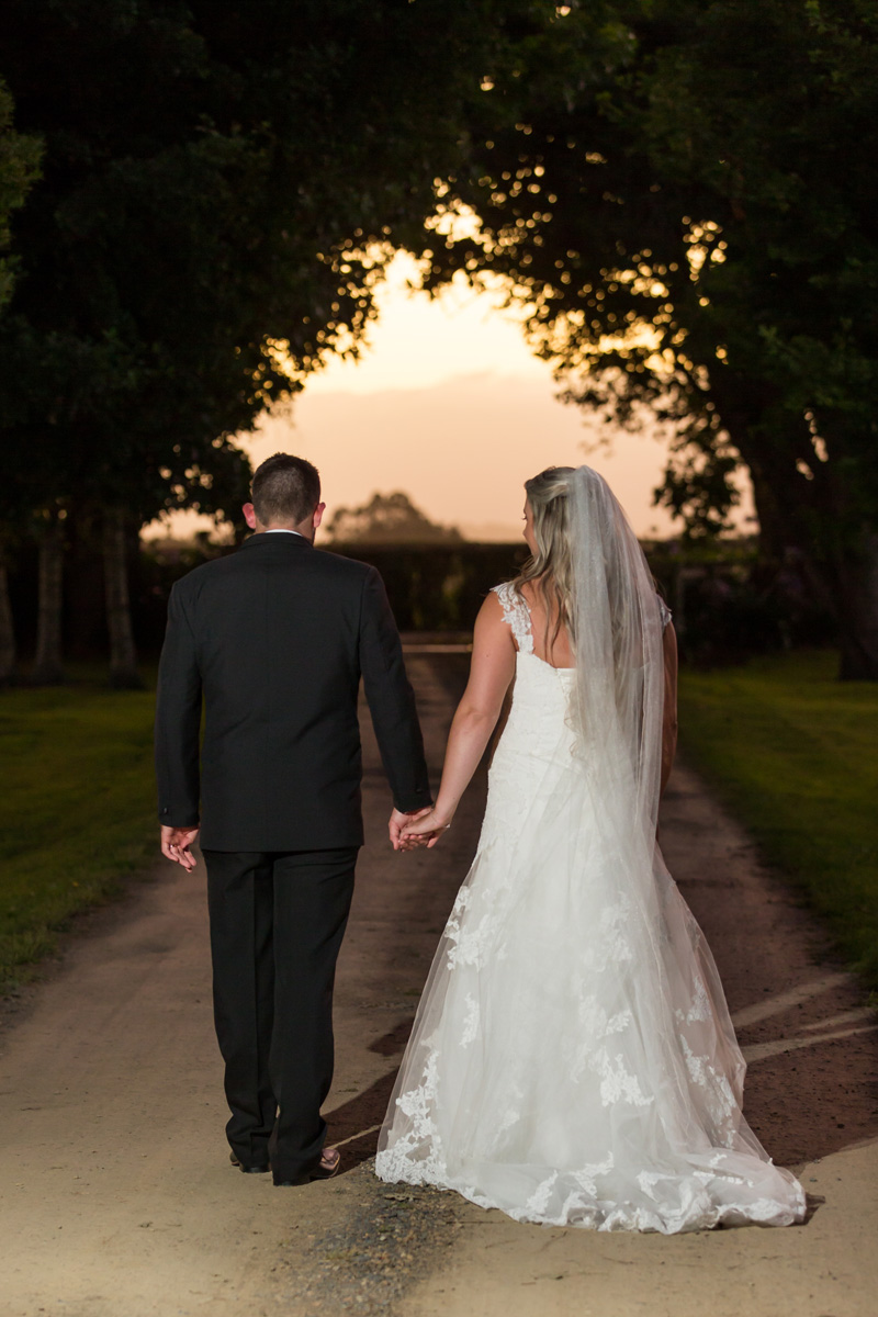Setting off in to the sunset at the end of a wonderful day | Astra Bride Trish | Maggie Sottero Marty |