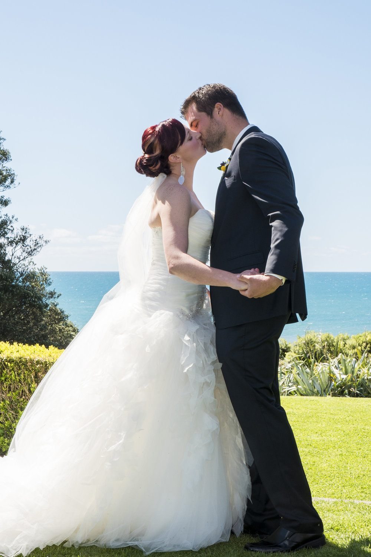 First Kiss | Astra Bride Jo | Bonny 229 | Taranaki wedding | Photography by Mark Bellringer |