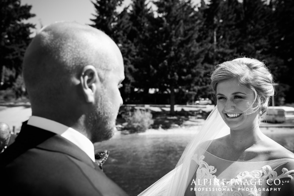 Astra Bride Hannah | Lakeside wedding | Maggie Sottero Cassandra | The bride and groom share a moment |