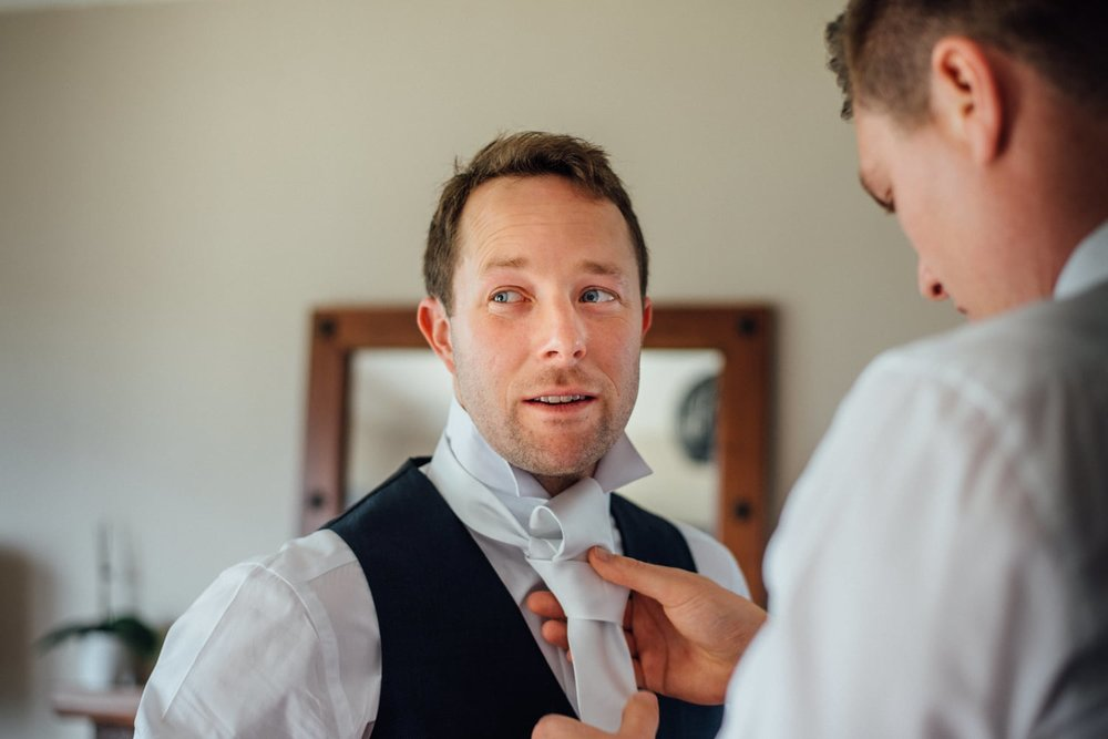 Astra Bride Jessica | Maggie Sottero Londyn | Red Barn Waikato | Photography by Tiffany Curtis | Groom preparation |