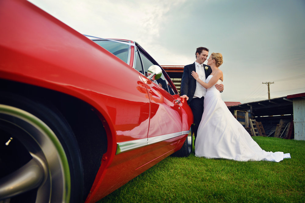 Red Wedding car | Rustic wedding | Farm theme | photography by Sonia Simpson | Gown from Astra Bridal | www.borrowedandblue.kiwi