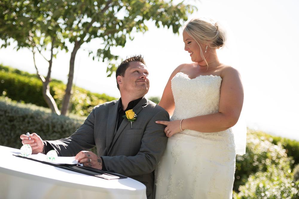 Signing the register | Astra Bride Sophia | Sileni Wine Estate | Maggie Sottero Emma | Lynda Gordon Photography