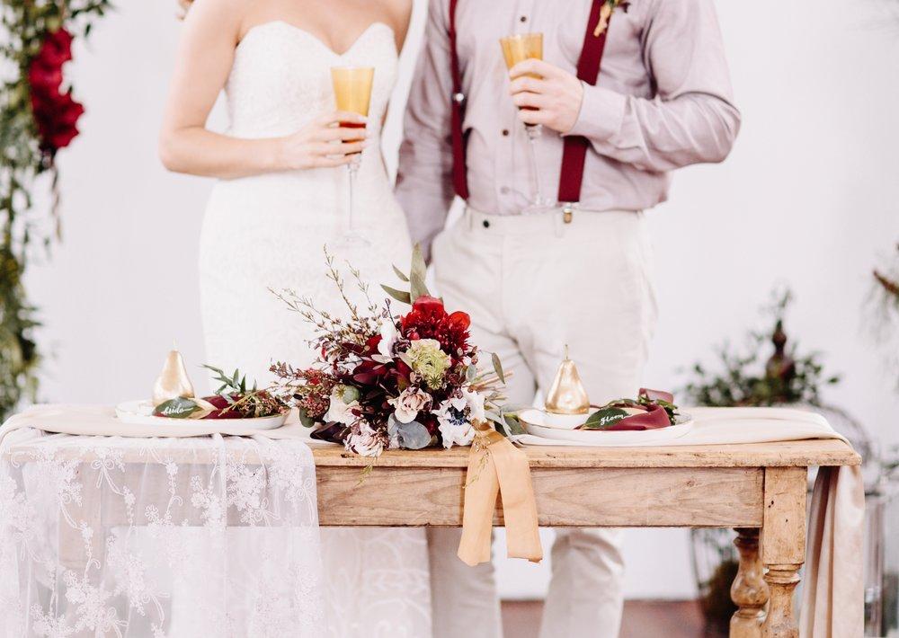 Wedding table decor | On Location | Red Boho Opulence | gown from Astra Bridal | www.borrowedandblue.kiwi | Photography by Proshot
