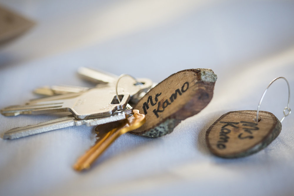 Key ring favour | Astra Bride Kylie | Christina Rossi 4246 | Kaimai Mamaku Forest | Creative Grain Photography |