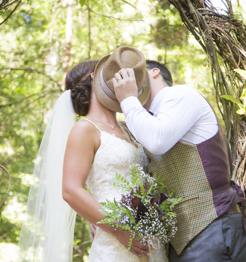 First kiss | Astra Bride Kylie | Christina Rossi 4246 | Kaimai Mamaku Forest | Creative Grain Photography |