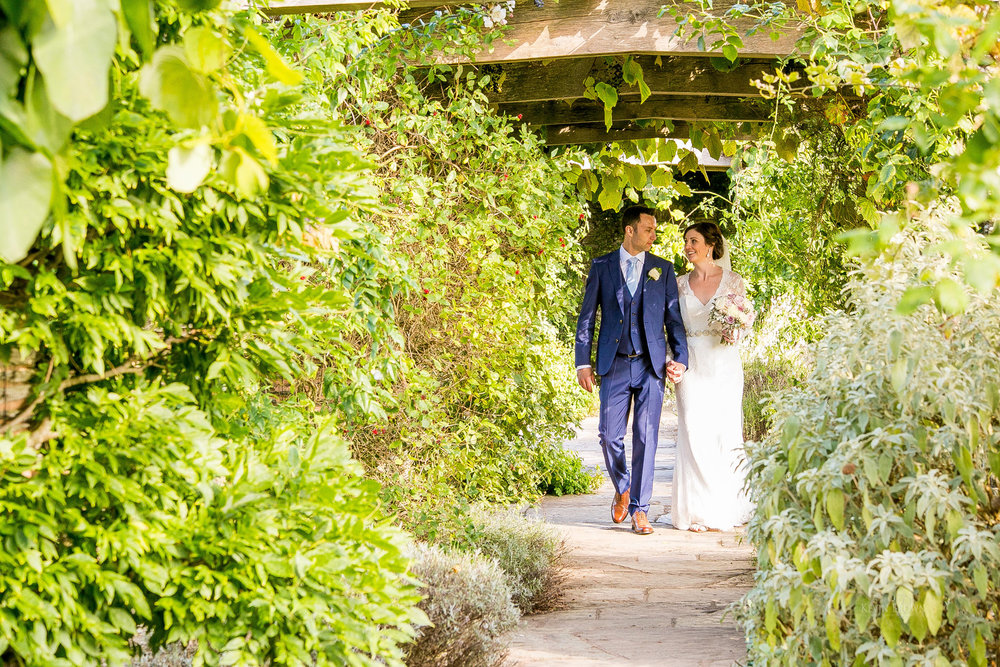 Covered garden walkway | Astra bride Pippa | Maggie Sottero Darla | Photography by Kevin Brown Photography | Darla exclusive in New Zealand to Astra Bridal |