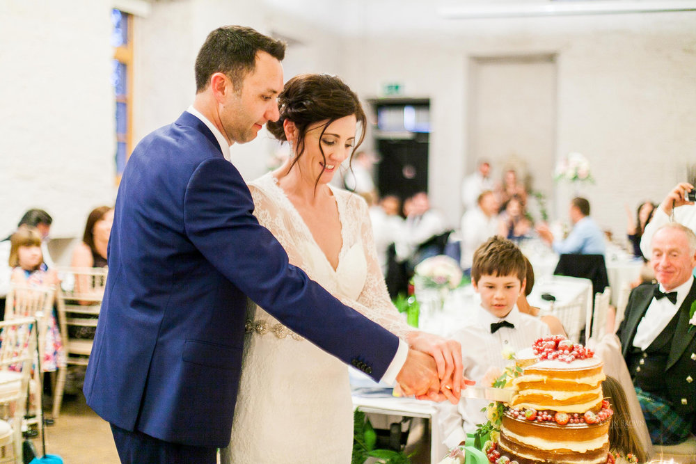 Cutting the cake | Astra bride Pippa | Maggie Sottero Darla | Photography by Kevin Brown Photography | Darla exclusive in New Zealand to Astra Bridal |