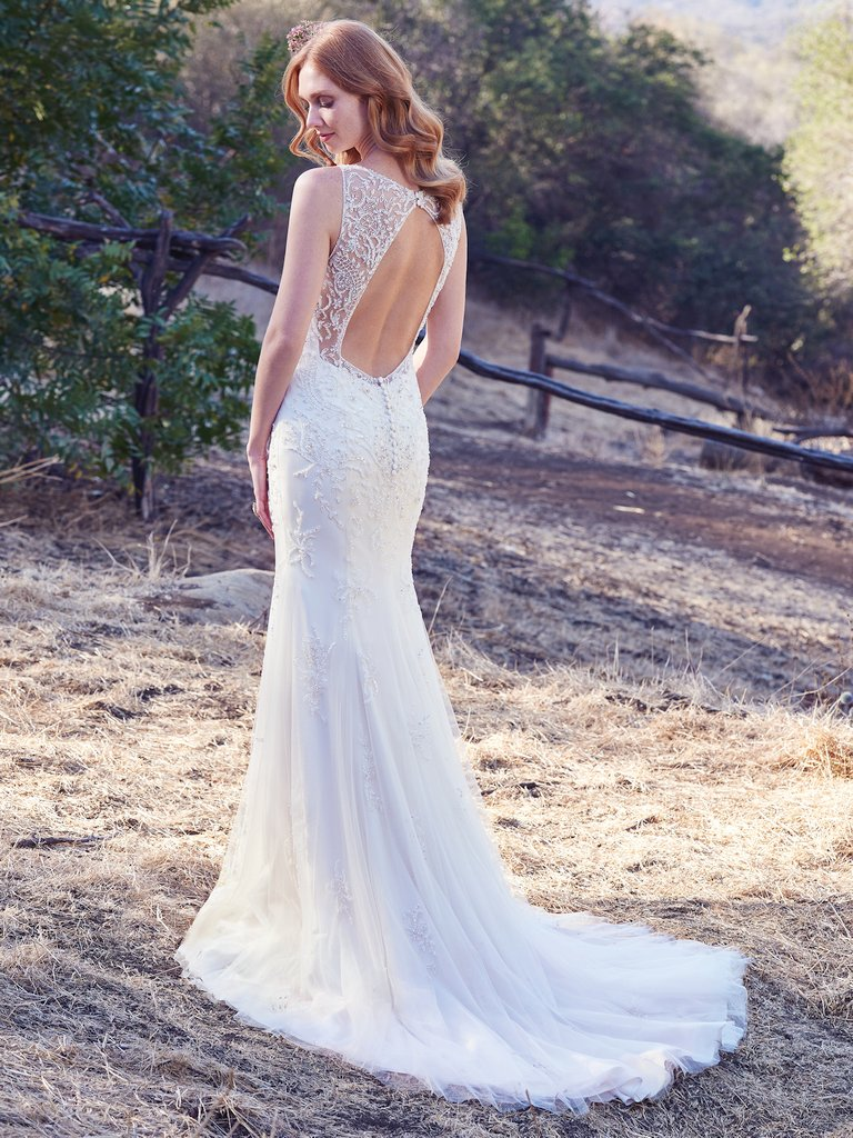 Kyra  by Maggie Sottero Flattering and sexy for the vintage-inspired bride.