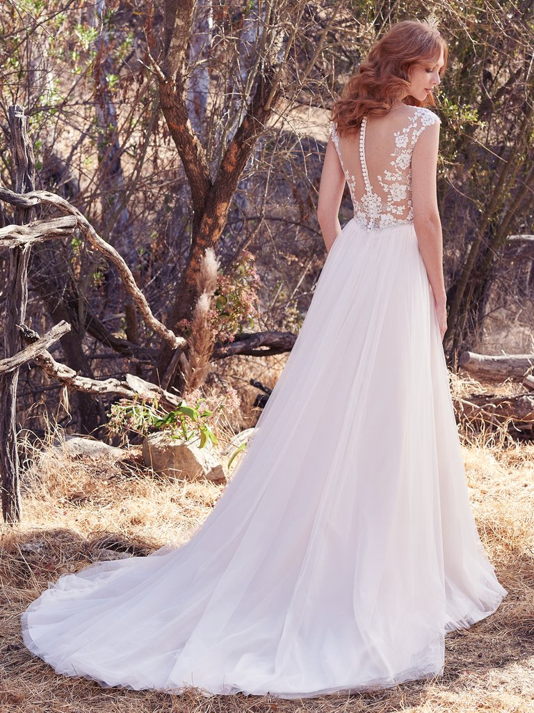 Sonja  by Maggie Sottero Dreamy and ladylike, yet oh-so-couture.
