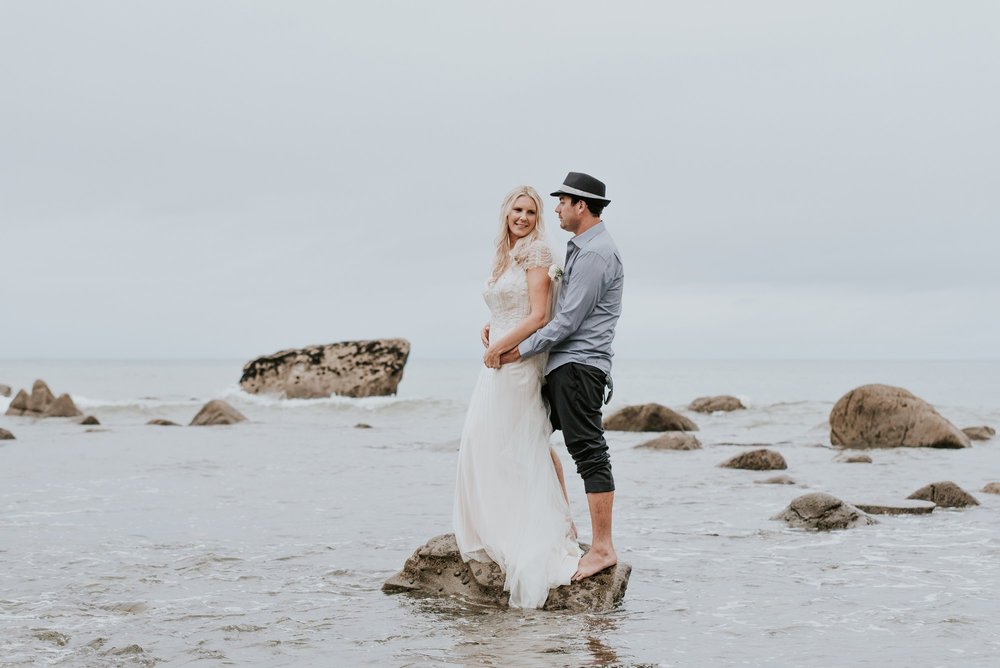 Talei and Jared in the water in Taranaki New Zealand | Astra Bride Talei | Maggie Sottero Ettia | The Bungalow Taranaki | Abi Hackling Photography |