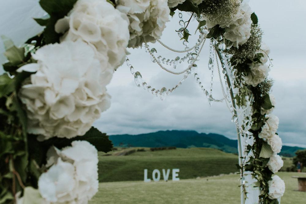Floral arch | Astra Bride Talei | Maggie Sottero Ettia | The Bungalow Taranaki | Abi Hackling Photography |