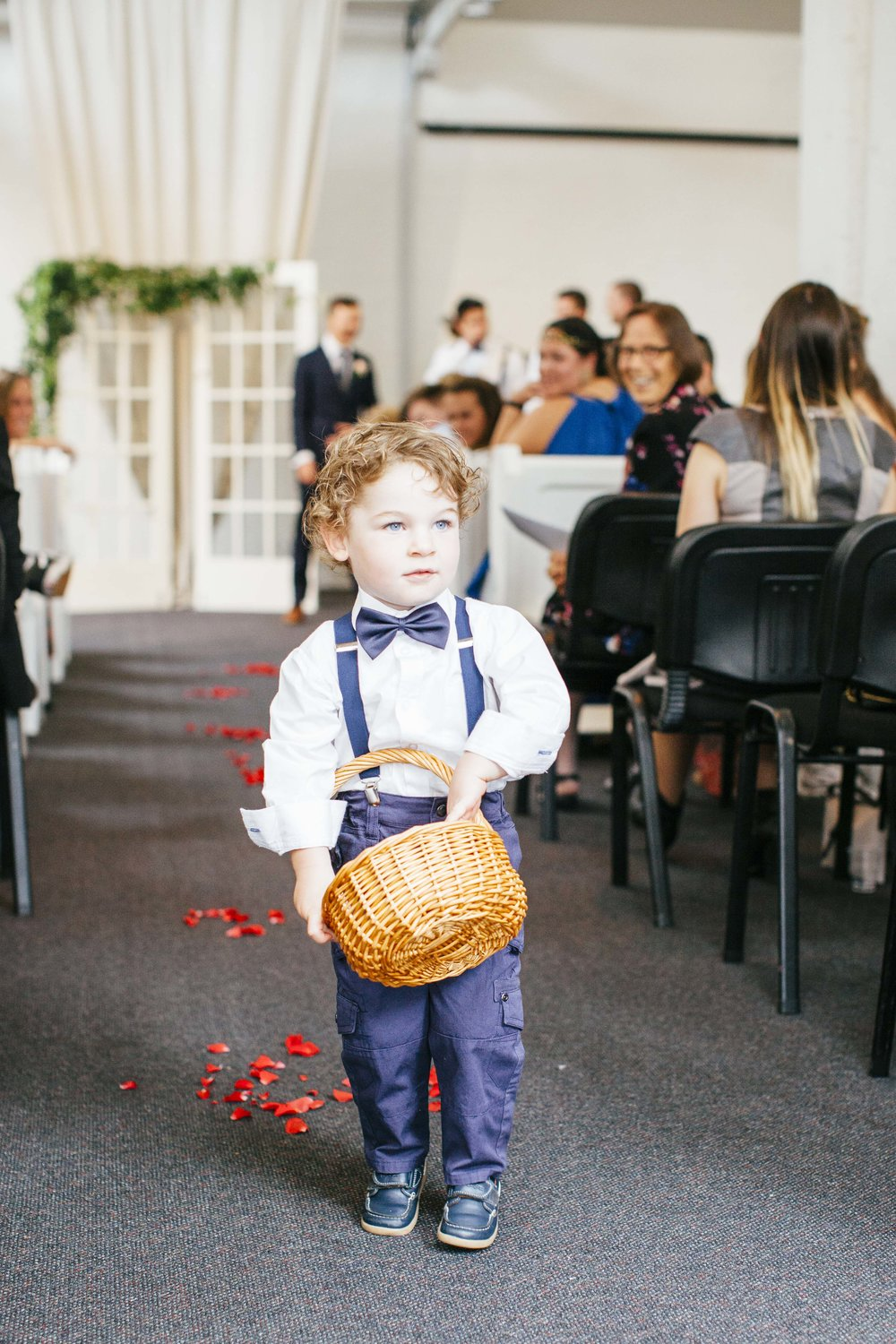 Super cute Pageboy scattering petals| Astra Bride Emma | Upper Room Church | Maggie Sottero Melinda | Wonder Ferris photography |