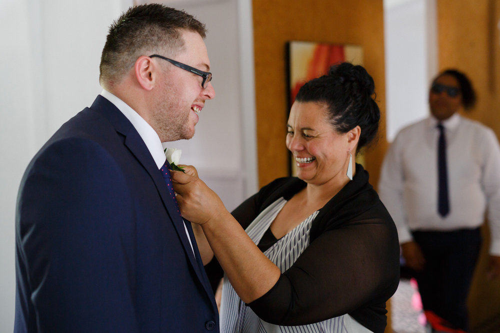 Kevin getting dressed | Astra bride Shanelle Simpson | Venue Tatum Park | Photographer Paul Howell |