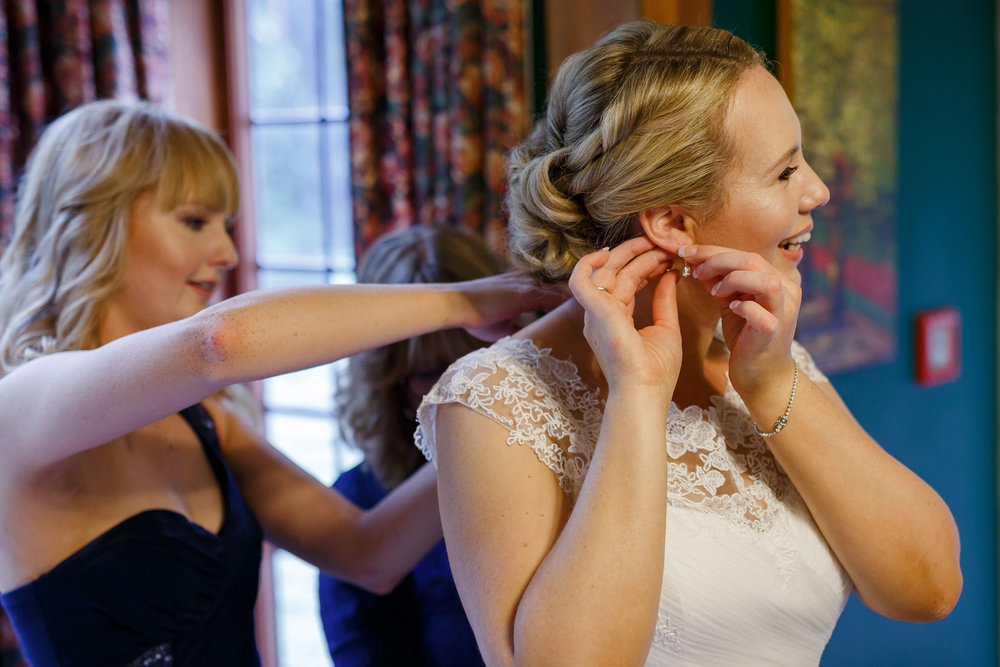 Getting dressed | Astra bride Shanelle Simpson | Maggie Sottero Patience | Venue Tatum Park | Photographer Paul Howell |