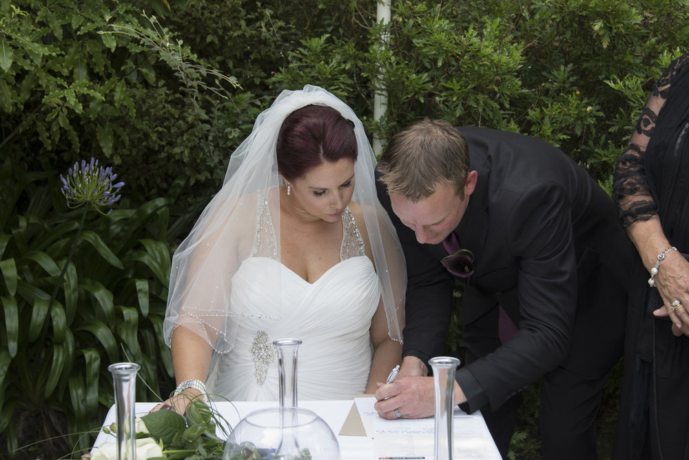 Signing the registry | Astra bride Jenni | Maggie Sottero gown | Wallaceville House | Paul Michaels Photography |