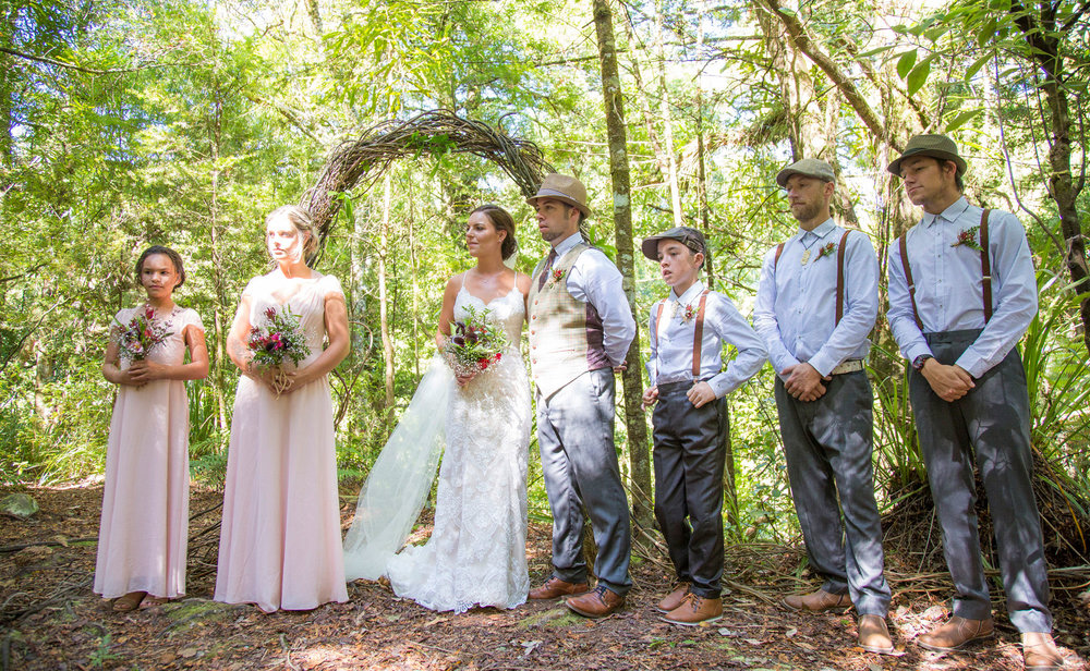 Kylie & Joel created the twisted vine arch to perfectly represent their wedding in the native bush of New Zealand | Photography by Creative Grain